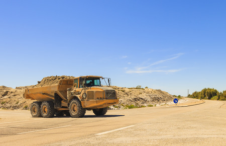 dumper: Heavy dump truck or dumper on the road