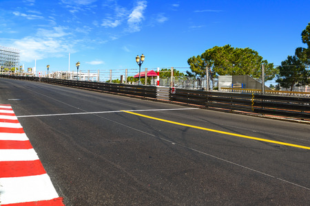 to bend: Monaco, Monte Carlo. Sainte Devote and Beau Rivage straight motor race asphalt on Grand Prix street circuit.
