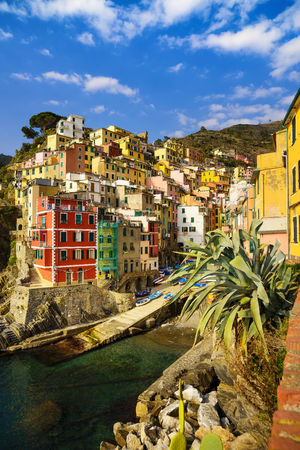 five: Riomaggiore village on cliff rocks and sea at sunset., Seascape in Five lands, Cinque Terre National Park, Liguria Italy Europe. Long Exposure