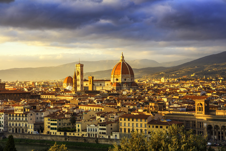 fiore: Florence or Firenze, Duomo Cathedral, Basilica Santa Maria del Fiore landmark and Giotto Campanile Sunset view from Michelangelo park square. Italy, Europe.
