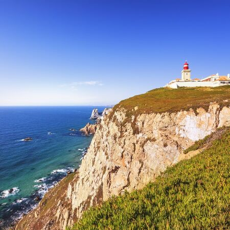 extent: Cabo de Roca, Portugal is the westernmost extent of continental europe. The lighthouse overlooking Atlantic Ocean. Stock Photo