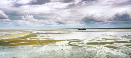 mont saint michel: Low tide in Mont Saint Michel Bay landmark. Normandy, France, Europe Stock Photo