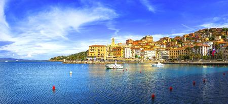 Porto Santo Stefano harbor seafront and village skyline, italian travel destination. Monte Argentario, Tuscany, Italy.