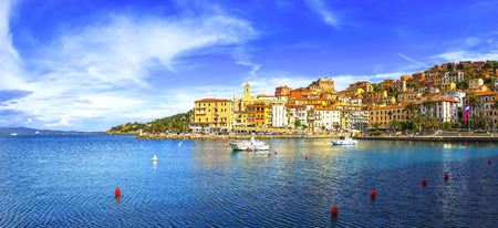 Porto Santo Stefano harbor seafront and village skyline, italian travel destination. Monte Argentario, Tuscany, Italy.