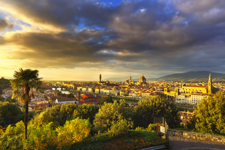 firenze: Florence or Firenze sunset aerial cityscape. Panorama view from Michelangelo park square. Ponte Vecchio bridge, Palazzo Vecchio and Duomo Cathedral. Tuscany, Italy Stock Photo