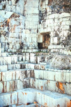 massa: White marble quarry with excavators. Carrara, Tuscany, Italy