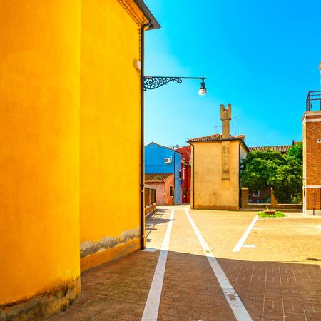italy street: Venice landmark, Burano island street, colorful houses, Italy, Europe.