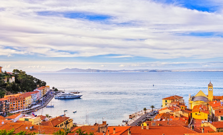 Porto Santo Stefano village, church and seafront panorama, italian travel destination. Monte Argentario, Tuscany, Italy.