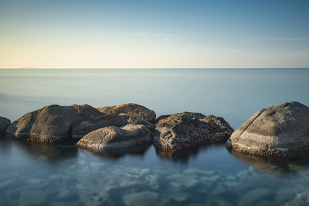 Rocks and sea in zen style. Long exposure photography