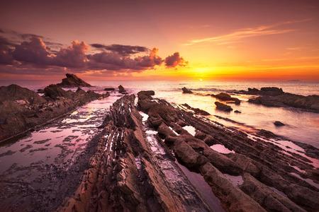 Rocks in a sea on sunset. Tuscany coast, Italy Europe