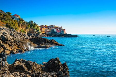 sea of houses: Tellaro rocks and old village on the sea. Church and houses. Five lands, Cinque Terre, Liguria Italy Europe.