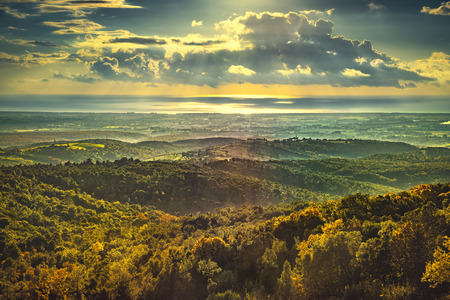 Maremma sunset panorama. Countryside, hills and sea on horizon. Val di Cecina Livorno coast, Tuscany, Italy Europe
