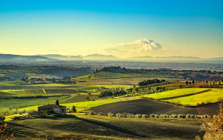 elba: Maremma, rural sunrise landscape. Countryside farm and green fields. Elba island and sea on horizon. Tuscany, Italy, Europe.