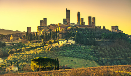 San Gimignano medieval town towers skyline and countryside landscape panorama on sunset. Tuscany, Italy, Europe.
