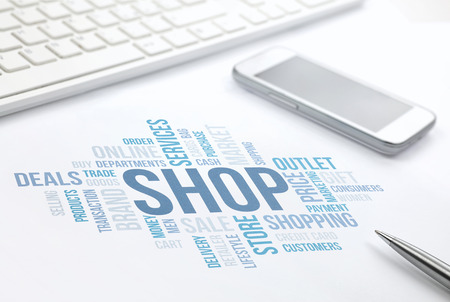 shopping malls: Shop concept word cloud print document, keyboard, pen and smartphone.