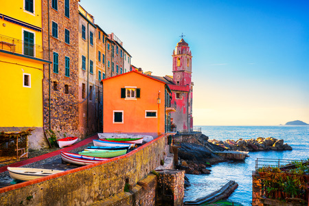 Tellaro sea village street, church and boats. Five lands, Cinque Terre, Liguria Italy Europe.