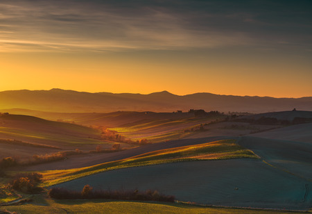 Maremma, rural panoramic sunset landscape. Meadows and fields. Tuscany, Italy, Europe.