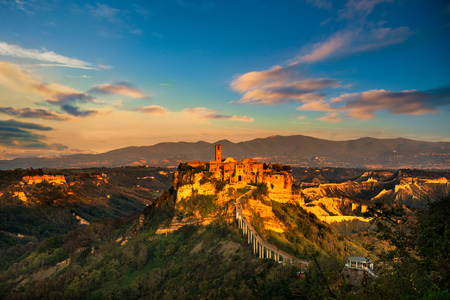 Civita di Bagnoregio ghost town landmark, aerial panoramic view on sunset. Lazio, Italy, Europe. Stock Photo