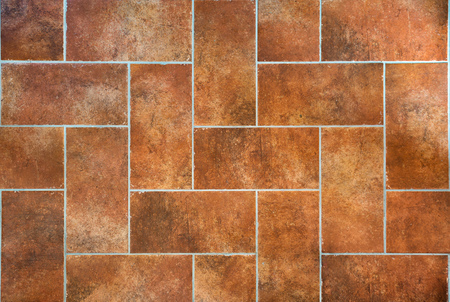 Tuscan traditional old and grunge floor, red ceramic stoneware tiles. Italian rural interior.