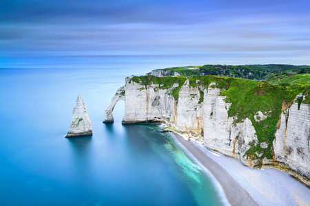 Etretat Aval cliff, rocks and natural arch landmark and blue ocean. Aerial view. Normandy, France, Europe. 스톡 콘텐츠