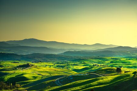 Volterra panorama, rolling hills, trees, and green fields at sunset. Tuscany Italy, Europe
