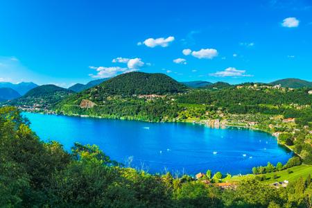 Orta Lake landscape. Orta San Giulio village and Alps mountains view, Piedmont, Italy, Europe.