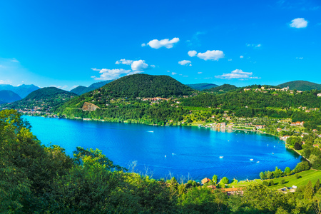 Orta Lake landscape. Orta San Giulio village and Alps mountains view, Piedmont, Italy, Europe.