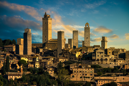 San Gimignano medieval town towers skyline and countryside landscape panorama at sunrise. Tuscany, Italy, Europe.