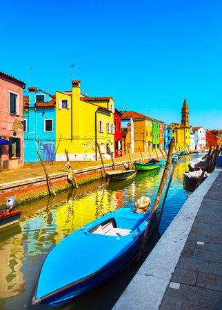 Venice landmark, Burano island canal, colorful houses and boats, Italy. Europe