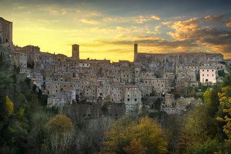 Tuscany, Sorano medieval village on tuff rocky hill. Panorama sunset. Italy, Europe.