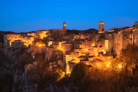 Tuscany, Sorano medieval village on tuff rocky hill. Blue hour sunset panorama. Italy, Europe. Stock Photo
