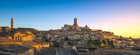Siena sunset panoramic skyline. Mangia tower and Cathedral Duomo landmark. Tuscany, Italy.