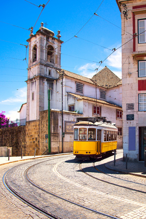Lisbon tram on urban tramway network. Alfama district Miradouro Santa Luzia route. Portugal, Europe.