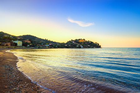 Porto Santo Stefano, headland and bay beach at sunset in Monte Argentario, Maremma Tuscany, Italy