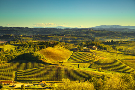 Panoramic view of countryside and chianti vernaccia vineyards from San Gimignano at sunrise. Tuscany, Italy, Europe.
