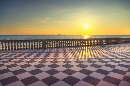 Mascagni Terrazza terrace belvedere seafront atr sunset, black and white checkerboard floor. Livorno Tuscany Italy Europe.