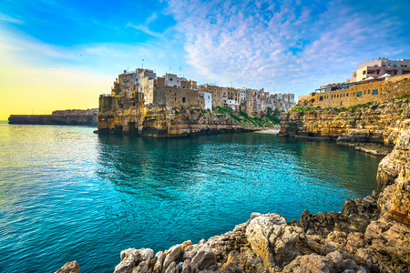 Polignano a Mare village on the rocks at sunrise, Bari, Apulia, southern Italy. Europe. Stok Fotoğraf
