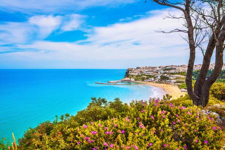 Peschici white village and beach, Gargano peninsula, Apulia, southern Italy, Europe. Фото со стока