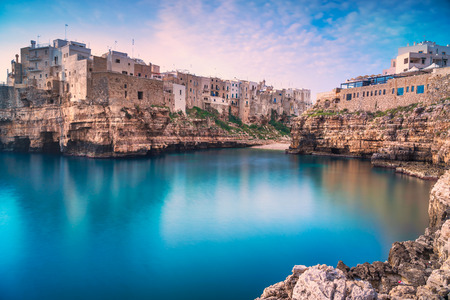 Polignano a Mare village on the rocks at sunrise, Bari, Apulia, southern Italy. Europe. Stock Photo