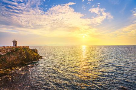 Sunset view of Piombino piazza bovio lighthouse and Elba Island. Maremma Tuscany Italy