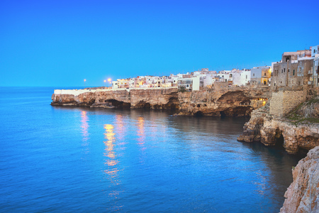 Polignano a Mare village on the rocks at sunset, Bari, Apulia, southern Italy. Europe. Imagens
