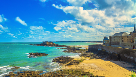 Saint Malo sand beach, city walls and Fort National. Low tide. Brittany, France, Europe.