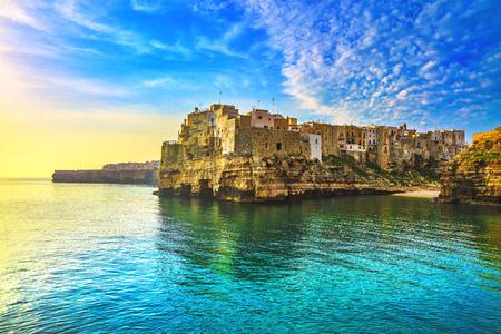 Polignano a Mare village on the rocks at sunrise, Bari, Apulia, southern Italy. Europe. Imagens
