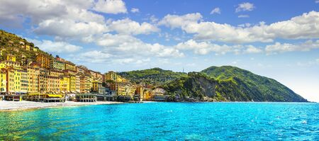 Camogli beach and typical colorful houses. Travel destination Ligury, Italy, Europe.