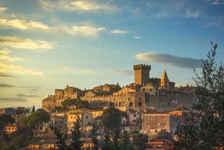 Capalbio medieval village skyline at sunset. Maremma Tuscany Italy Europe