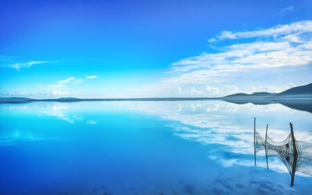 Orbetello lagoon panorama and fish nets, Argentario, Italy Europe