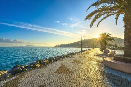 Seafront promenade or esplanade in Porto Santo Stefano at sunrise, Monte Argentario, Tuscany, Italy. Imagens