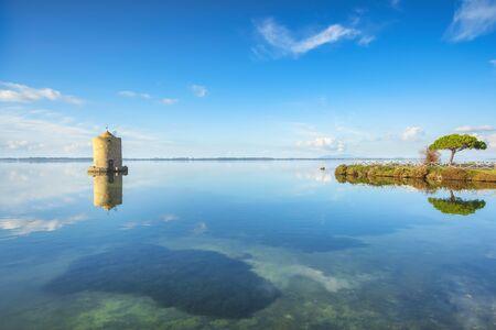 Old spanish windmill in Orbetello lagoon, medieval landmark in Monte Argentario, Tuscany, Italy.