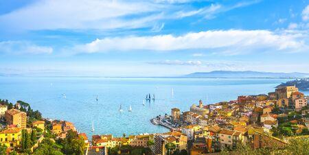 Porto Santo Stefano panoramic view and sailing regatta. Monte Argentario, Maremma Tuscany, Italy.