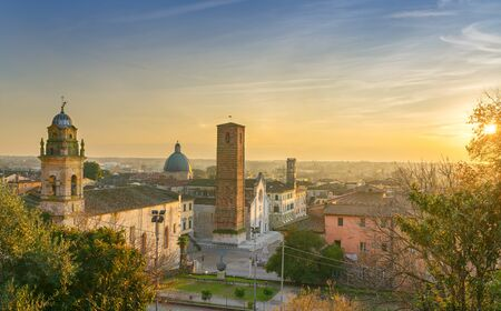 Pietrasanta old town aerial view at sunset, San Martino cathedral and torre civica. Versilia Lucca Tuscany Italy Europe